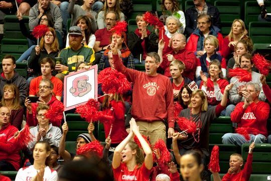 Todd Miklos, standing middle, cheers for his daughter Halley Miklos, who attended Liberty Common High School and now plays for Cornell University, during a game at Moby Arena on Sunday, November 25, 2018.