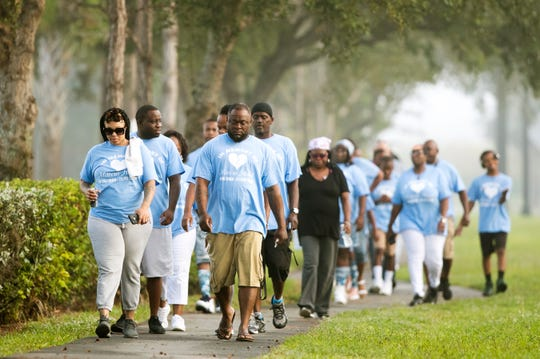 More than 35 family members and friends of Marcus Hood take part in a memorial walk in his honor on Sunday in San Carlos Park. Hood was killed two years ago in a shooting at the Gulf Coast Town Center. The four-mile walk began at the center and ended at Cypress View Drive where emergency personnel found Hood.