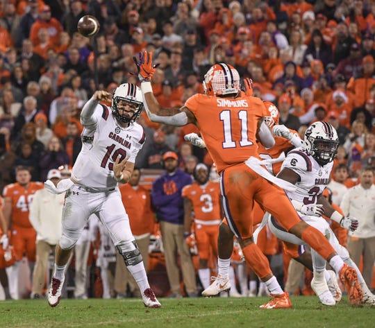 South Carolina quarterback Jake Bentley throws near Clemson safety Isaiah Simmons (11) during the second quarter in Memorial Stadium on Saturday, November 24, 2018.