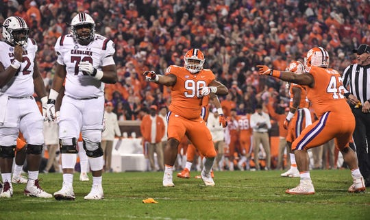 Clemson defensive lineman Dexter Lawrence (90) and Clemson defensive lineman Christian Wilkins (42) react after South Carolina got a penalty during the first quarter in Memorial Stadium on Saturday, November 24, 2018.