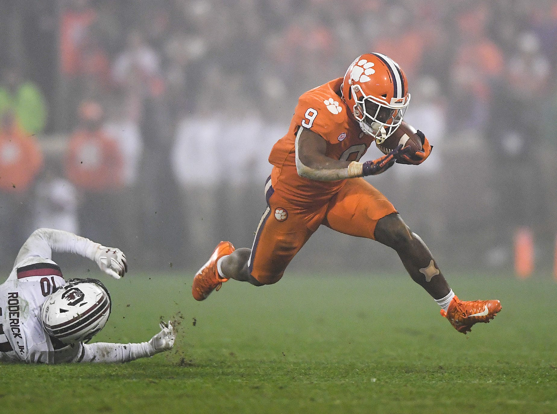 South Carolina safety R.J. Roderick (10) can't stop Clemson running back Travis Etienne (9) during the 4th quarter Saturday, November 24, 2018 at Clemson's Memorial Stadium.