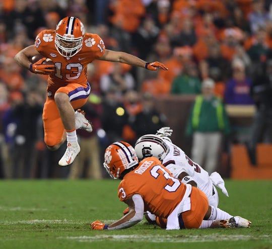 Clemson wide receiver Hunter Renfrow (13) leaps over South Carolina cornerback Keisean Nixon (9) after a reception during the 1st quarter Saturday, November 24, 2018 at Clemson's Memorial Stadium.