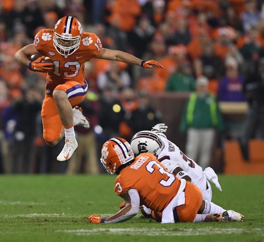 Clemson wide receiver Hunter Renfrow (13) leaps over South Carolina cornerback Keisean Nixon (9) after a reception during the 1st quarter Saturday, November 24, 2018 at Clemson's Memorial Stadium.