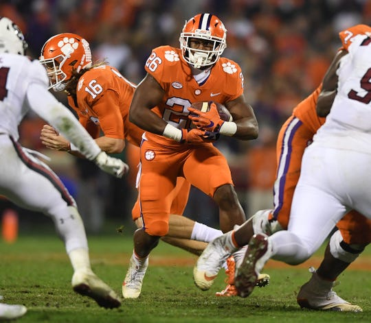 Clemson running back Adam Choice (26) carries against South Carolina during the 2nd quarter Saturday, November 24, 2018 at Clemson's Memorial Stadium.