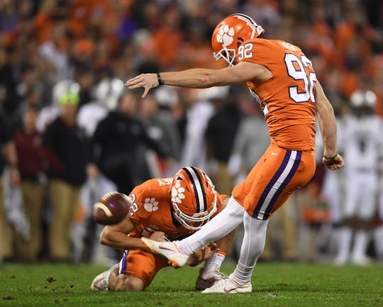 Clemson place kicker Greg Huegel (92) kicks an extra point against South Carolina during the 2nd quarter Saturday, November 24, 2018 at Clemson's Memorial Stadium.