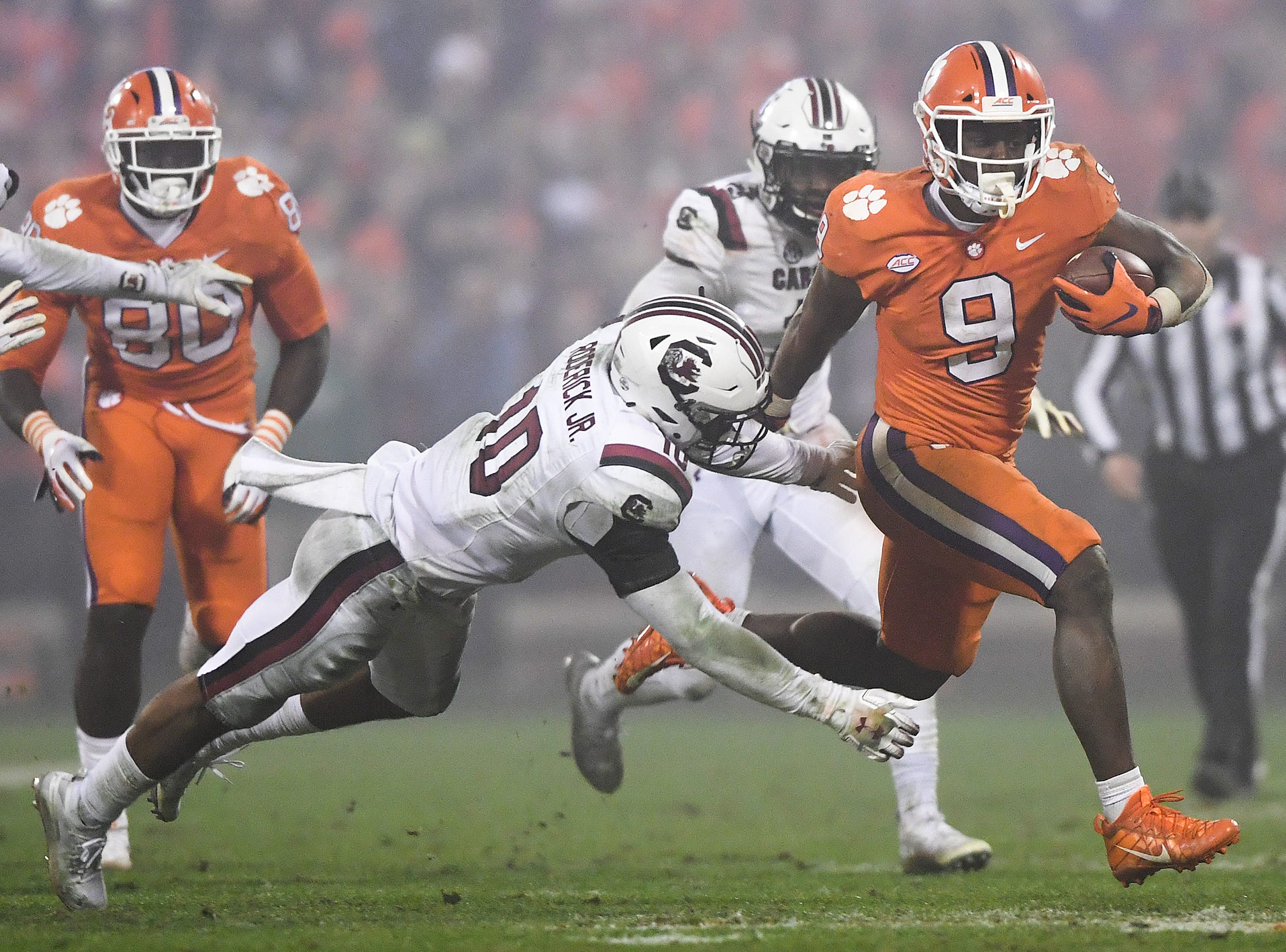 South Carolina safety R.J. Roderick (10) tries to stop Clemson running back Travis Etienne (9) during the 4th quarter Saturday, November 24, 2018 at Clemson's Memorial Stadium.