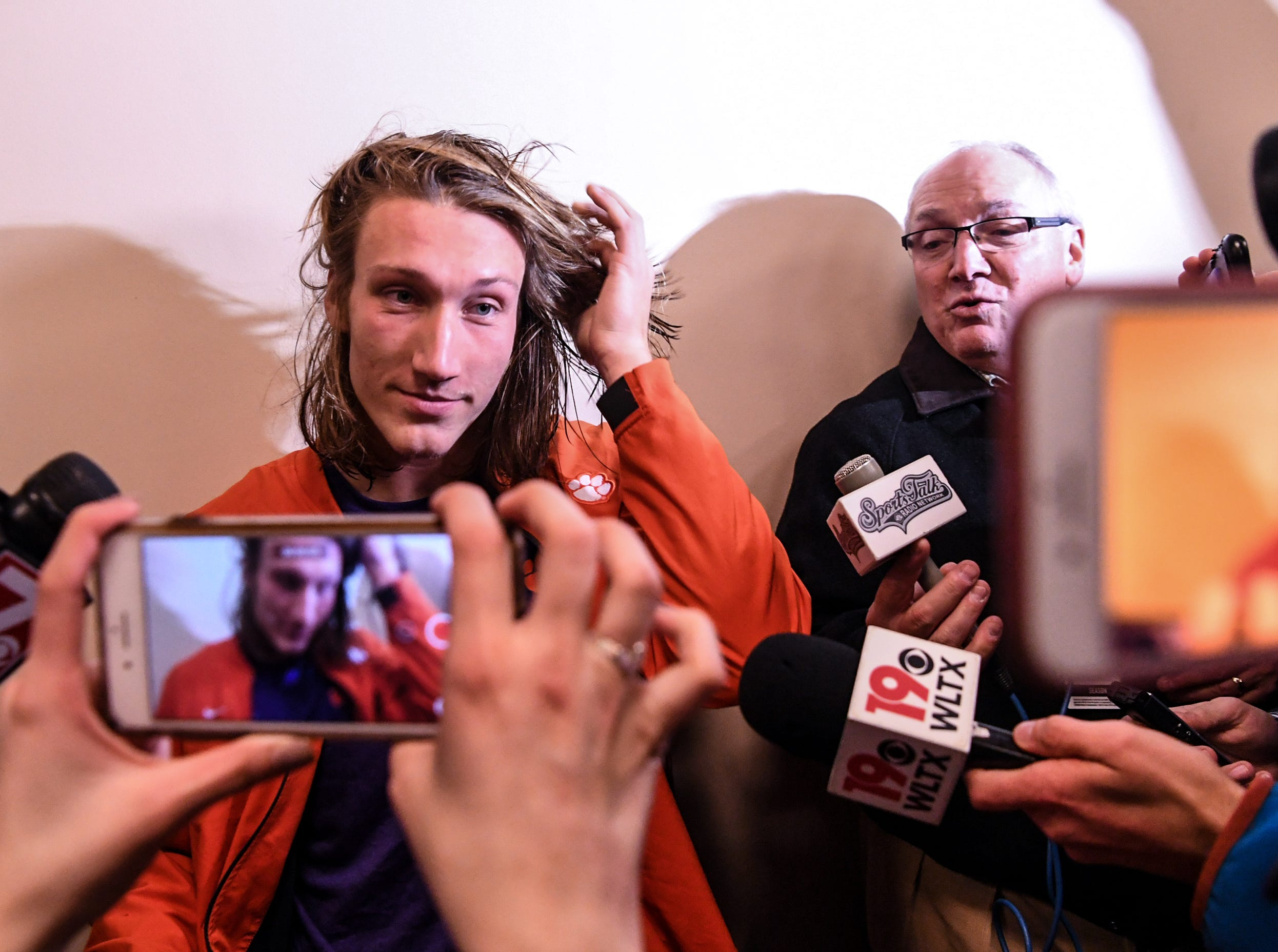 Clemson quarterback Trevor Lawrence fixes his hair as he arrives for a postgame interview after the game with South Carolina in Memorial Stadium on Saturday, November 24, 2018.