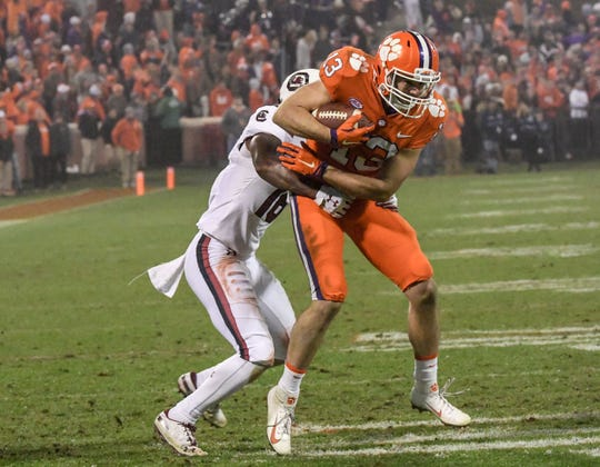 Clemson wide receiver Hunter Renfrow (13) catches a ball near South Carolina defensive back Rashad Fenton(16) during the fourth quarter in Memorial Stadium on Saturday, November 24, 2018.