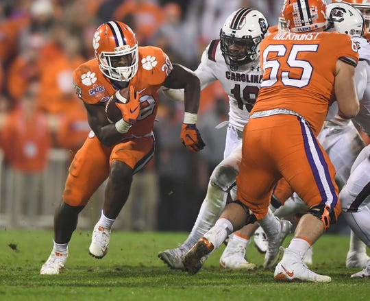 Clemson running back Tavien Feaster (28) carries against South Carolina during the 3rd quarter Saturday, November 24, 2018 at Clemson's Memorial Stadium.