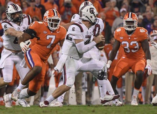 Clemson defensive lineman Austin Bryant (7) sacks South Carolina quarterback Jake Bentley.