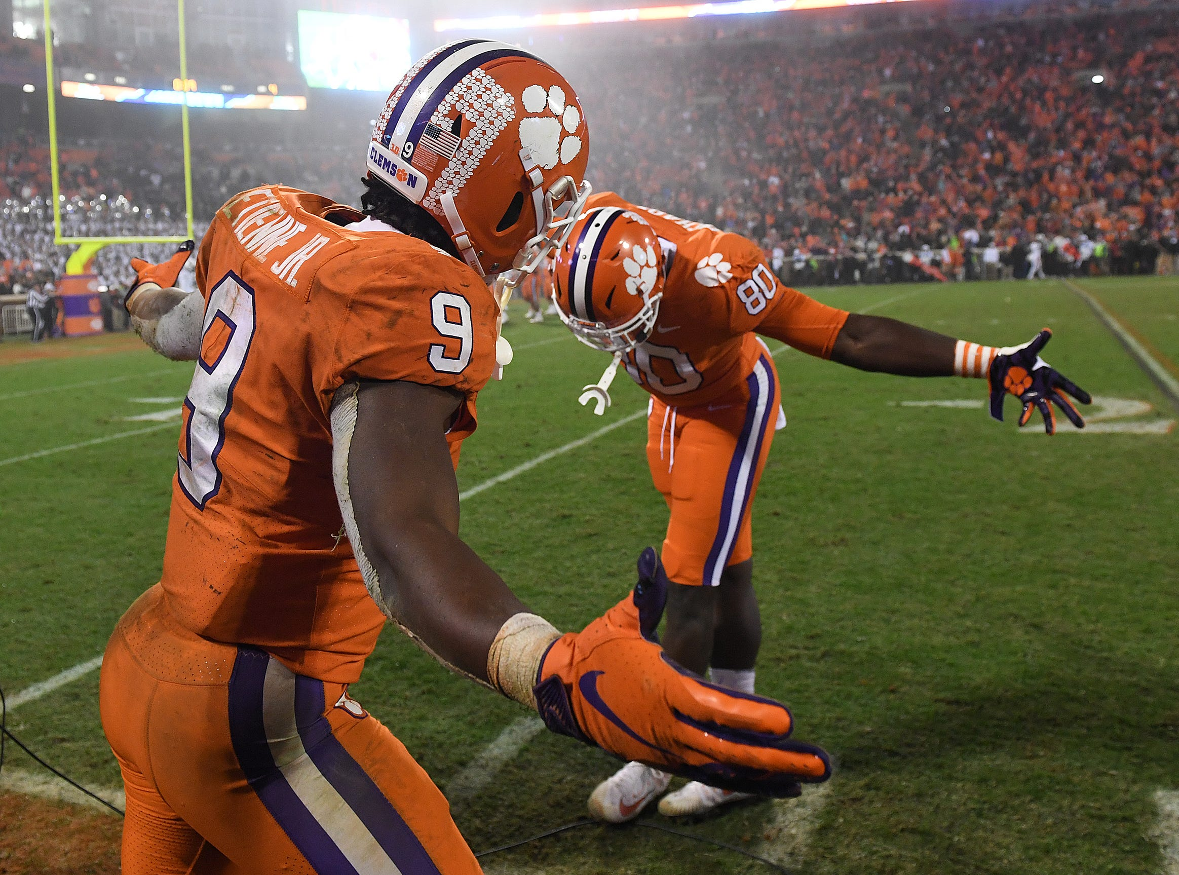 Clemson tight end Milan Richard (80) bows to running back Travis Etienne (9) after Etienne scored against South Carolina during the 4th quarter Saturday, November 24, 2018 at Clemson's Memorial Stadium.