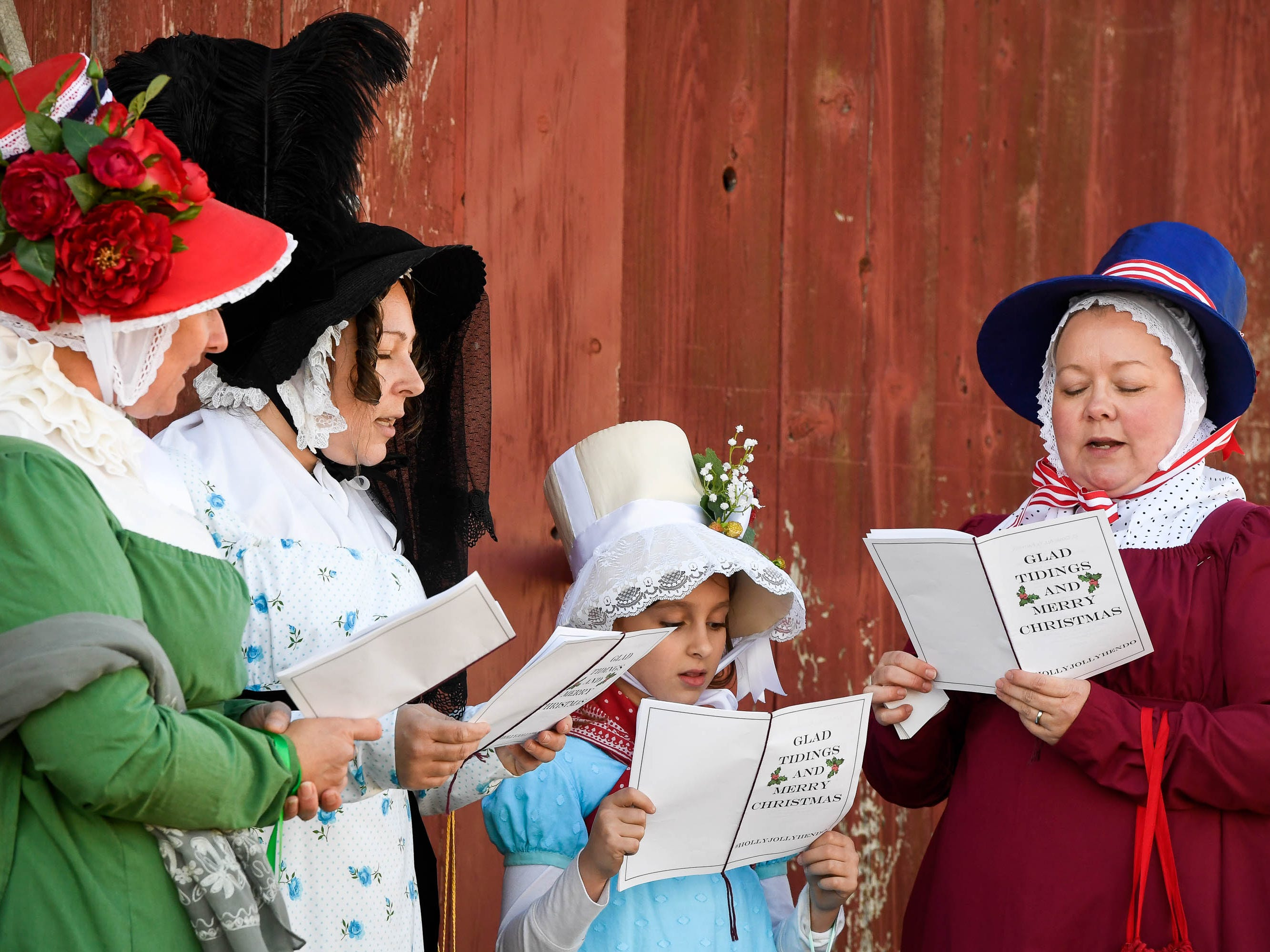 The singing group Holly Jolly Hendo left to right, Heidi McCain, Jennifer Gardner, Eleanor Gardner, nine years-old, and Shannon Hutton sing Christmas Carols at the Christmas on the farm fund raising event for the Healing Reins Therapeutic Riding program Saturday. The family friendly event features pony rides, hay rides, vendor mall and barbecue, November 24, 2018.