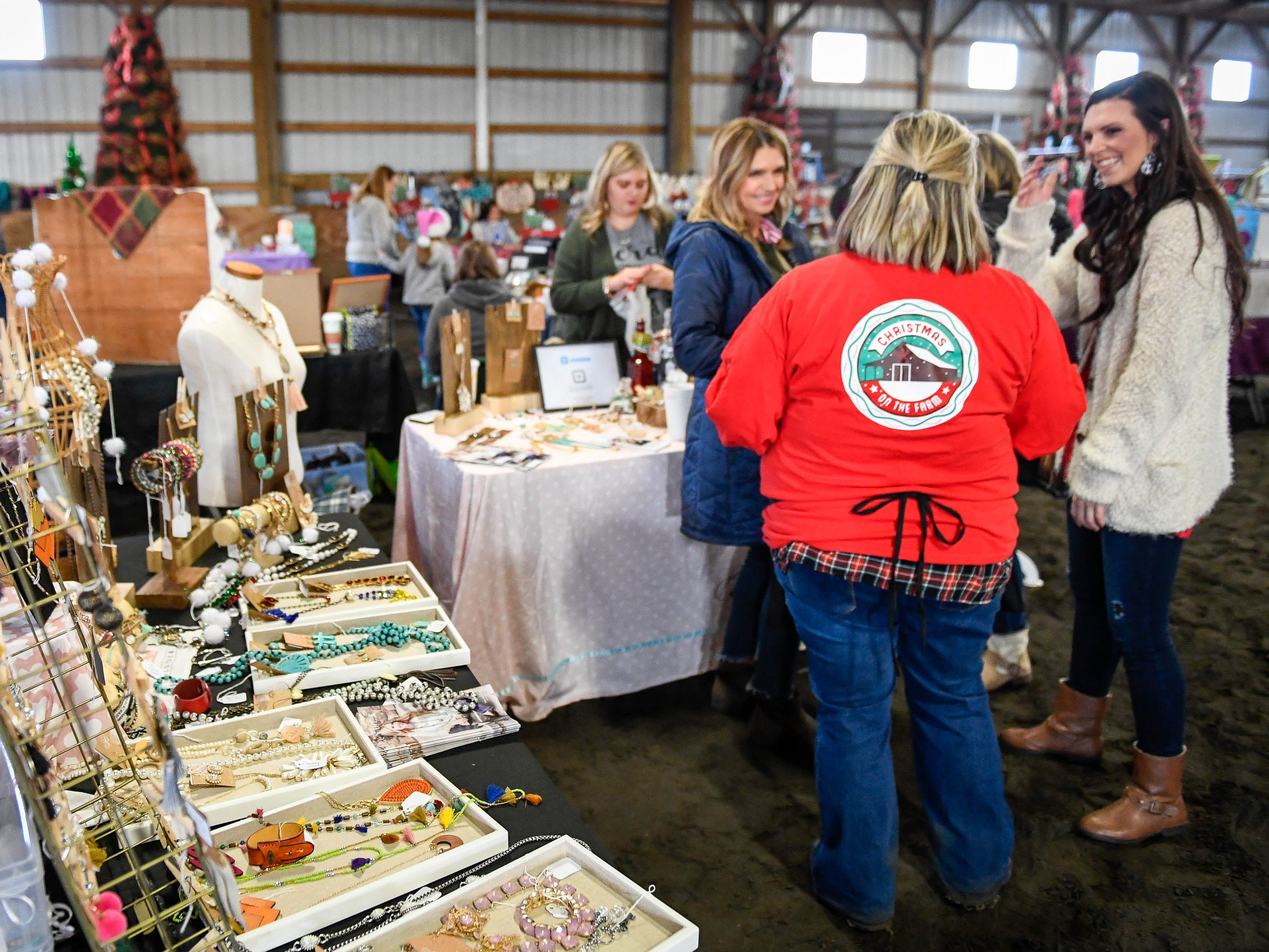 Holiday shoppers in a vendor mall at the Christmas on the farm fund raising event for the Healing Reins Therapeutic Riding program Saturday. The family friendly event features pony rides, hay rides and barbecue, November 24, 2018.