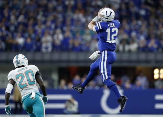 Indianapolis Colts quarterback Andrew Luck (12) catches a pass from Jacoby Brissett  in the first half of their game at Lucas Oil Stadium on Sunday, Nov. 25, 2018.