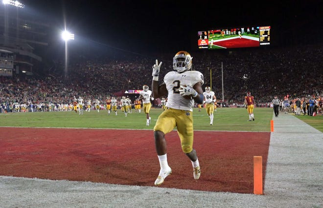 Notre Dame Fighting Irish running back Dexter Williams (2) celebrates after scoring on a 52-yard touchdown run in the third quarter against the Southern California Trojans at Los Angeles Memorial Coliseum.