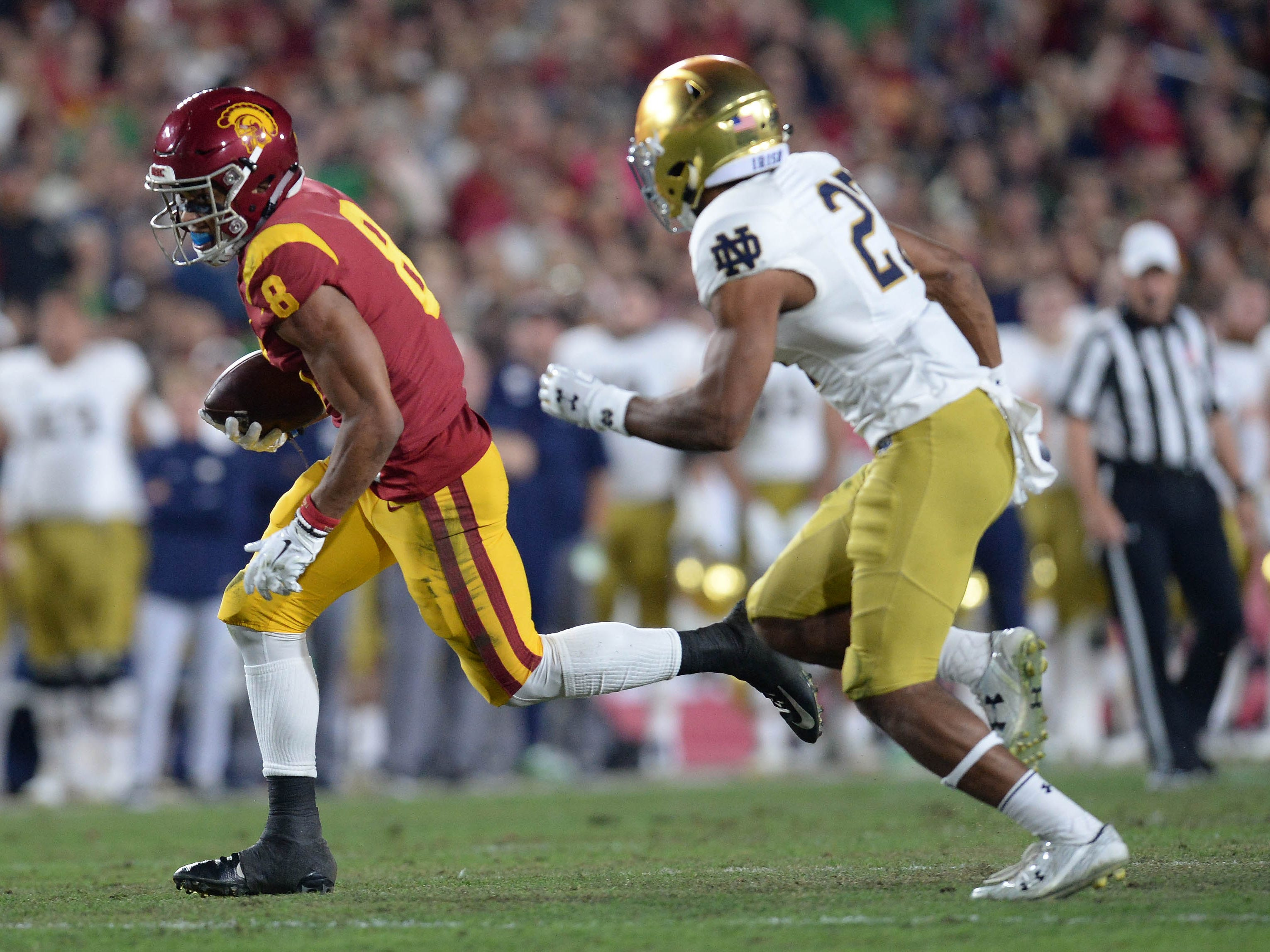 Southern California Trojans wide receiver Amon-Ra St. Brown (8) runs the ball against the Notre Dame Fighting Irish during the first half at the Los Angeles Memorial Coliseum.