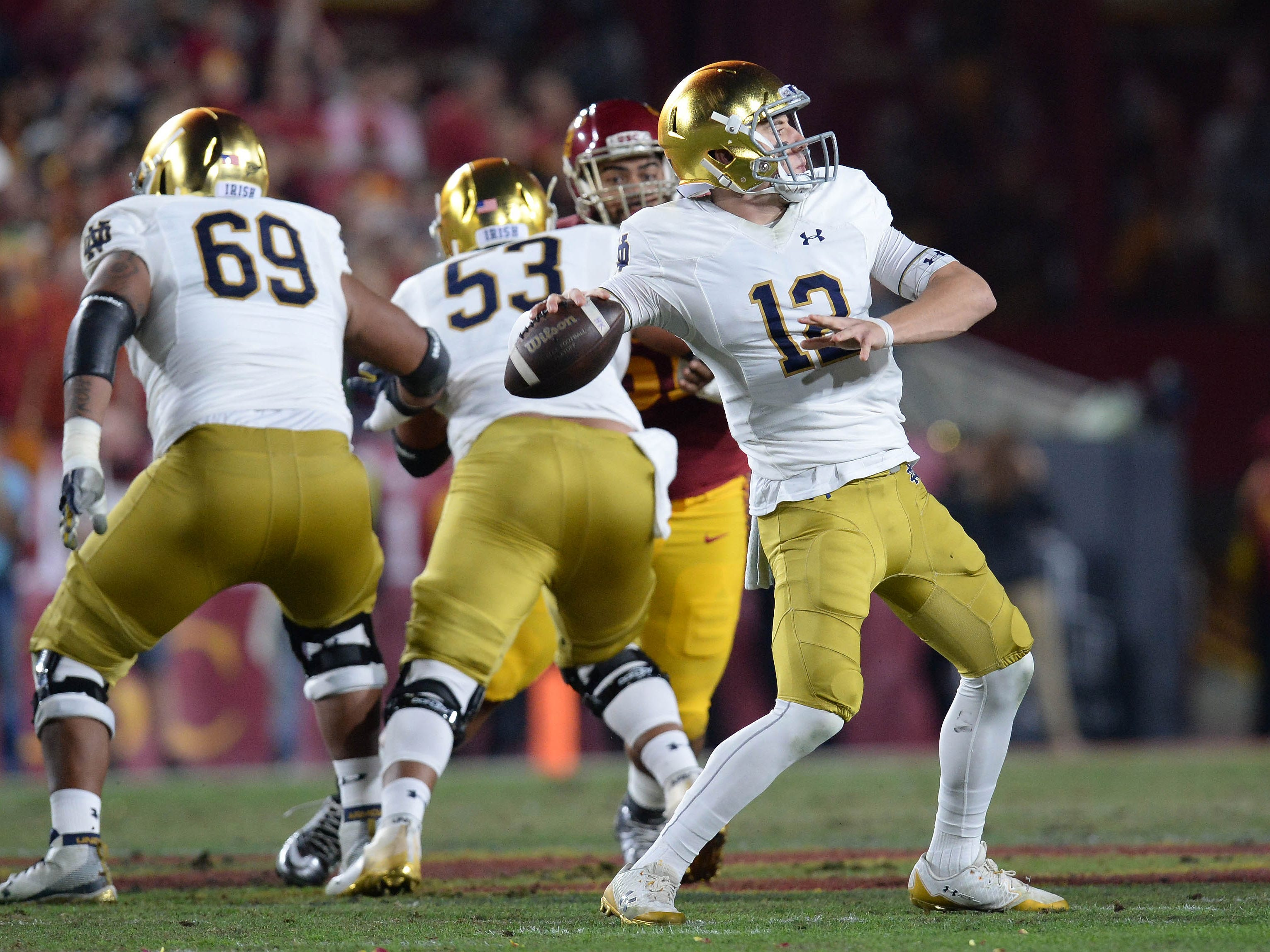 Notre Dame Fighting Irish quarterback Ian Book (12) throws against the Southern California Trojans during the first half at the Los Angeles Memorial Coliseum.
