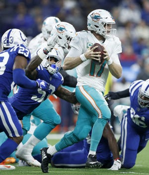 Colts outside linebacker Darius Leonard (53) comes in to sack Dolphins quarterback Ryan Tannehill (17) on Sunday.