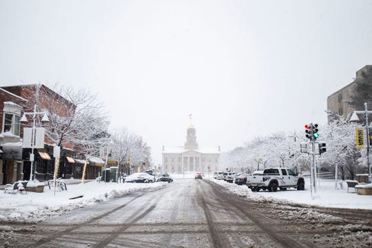 The Old Capitol Building is seen during a storm on Sunday, Nov. 25, 2018, from Iowa Avenue in Iowa City.