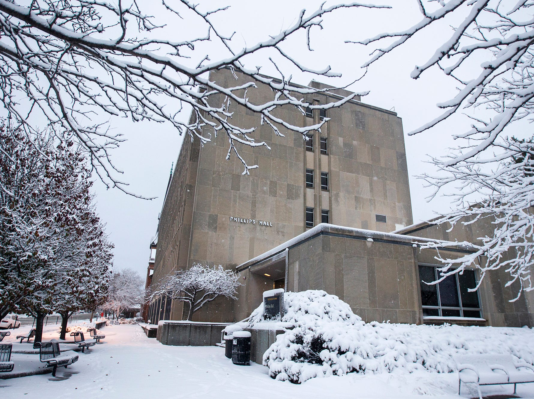 Snow falls on Phillips Hall during a storm on Sunday, Nov. 25, 2018, in Iowa City.