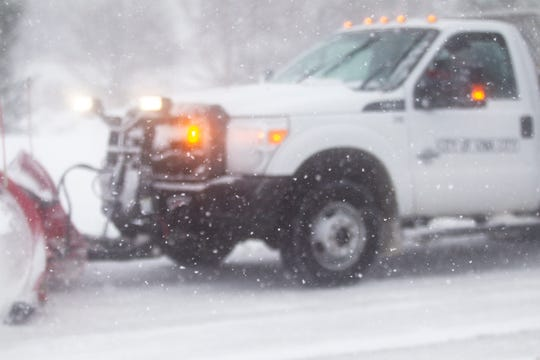 An Iowa City snow plow clears a roadway as snow falls during a storm on Sunday, Nov. 25, 2018, on the east side of Iowa City. AccuWeather anticipated Iowa City to have a total of 6-10 inches of snow.