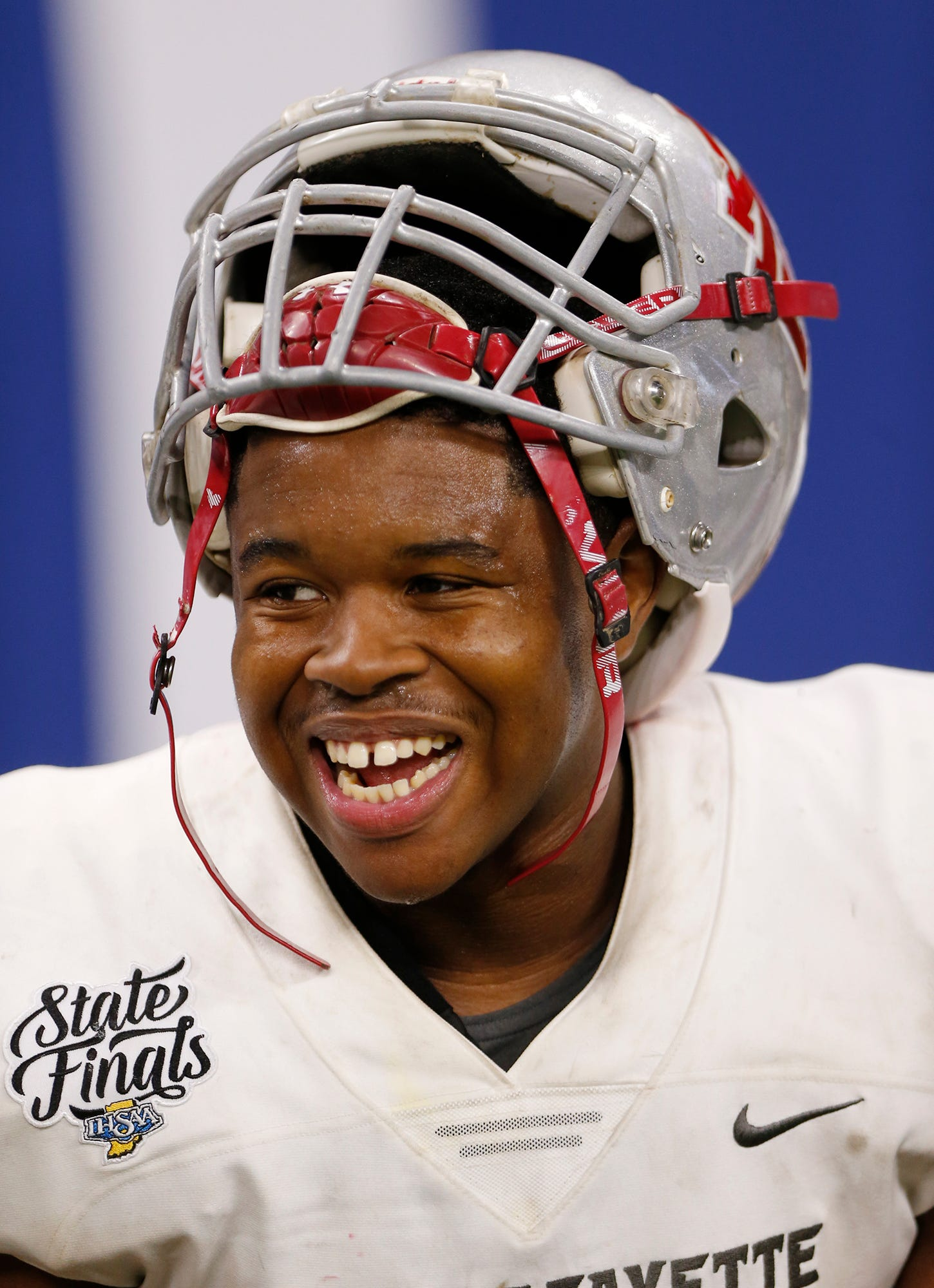 Lamont Johnson of West Lafayette smiles on the sidelines as the Red Devils battle Evansville Memorial in the fourth quarter in the Class 3A State Championship Saturday, November 24, 2018, at Lucas Oil Stadium in Indianapolis. West Lafayette defeated Evansville Memorial 47-42 to claim the Class 3A state title.