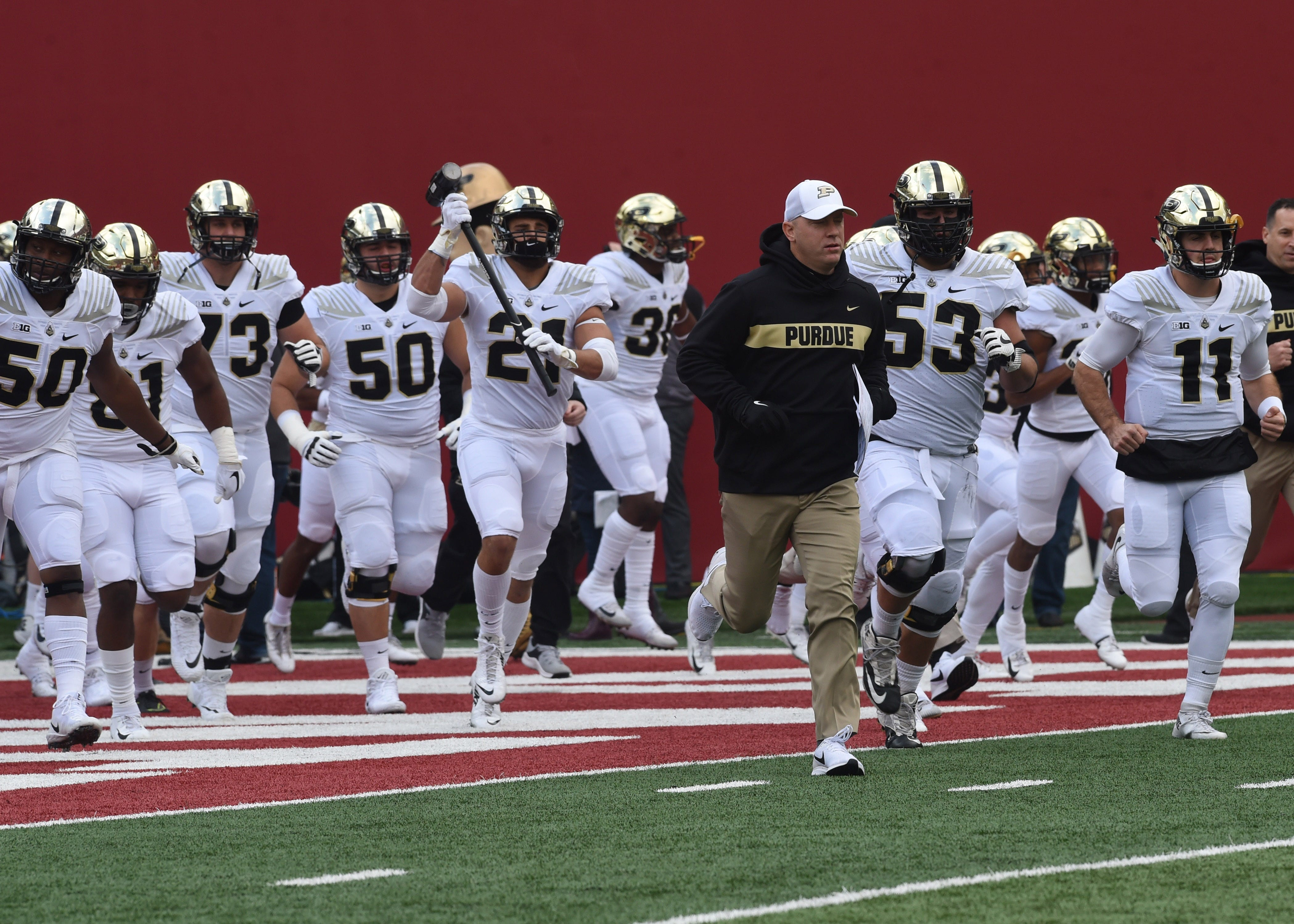 Head coach Jeff Brohm leads his Purdue football team onto the Memorial Stadium field Saturday, Nov. 24, 2018.