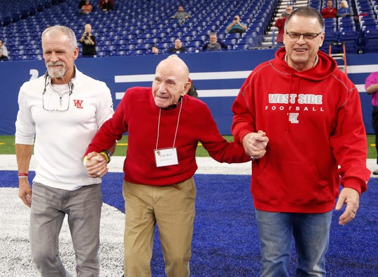 Ernie Beck, center, was recognized at the 2018 Indiana football state championships alongside former Red Devil coaches Lane Custer, left, and Marshall Overley, right.