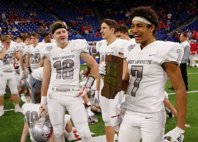 Kyle Hazell of West Lafayette is all smiles after being named the mental attitude award winner for Class 3A following the Red Devils 47-42 victory over Evansville Memorial in the Class 3A State Championship Saturday, November 24, 2018, at Lucas Oil Stadium in Indianapolis.