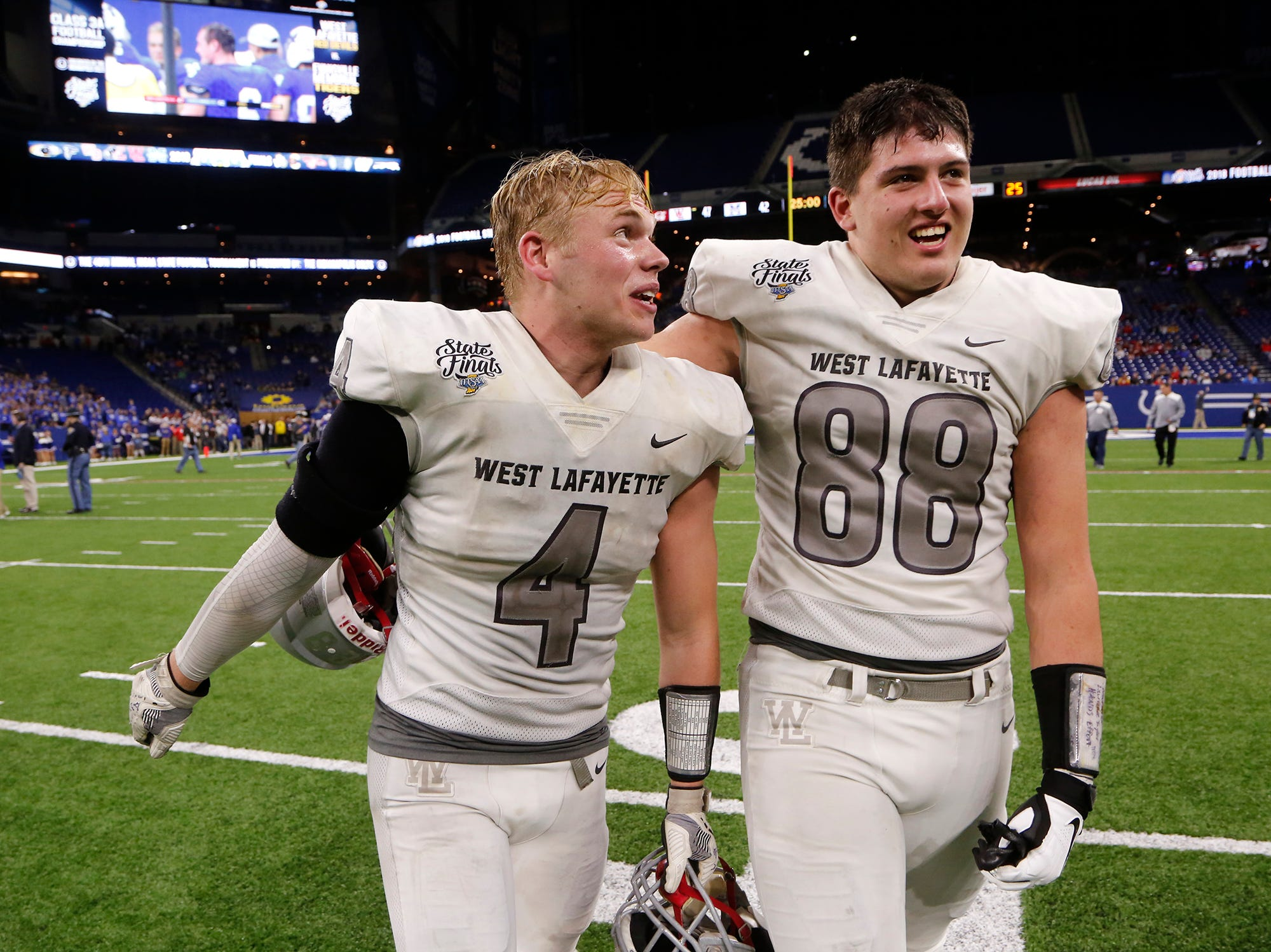 Ben Szymanski, left, and George Karlaftis of West Lafayette celebrate after the Red Devils defeated Evansville Memorial 47-42 in the Class 3A State Championship Saturday, November 24, 2018, at Lucas Oil Stadium in Indianapolis.