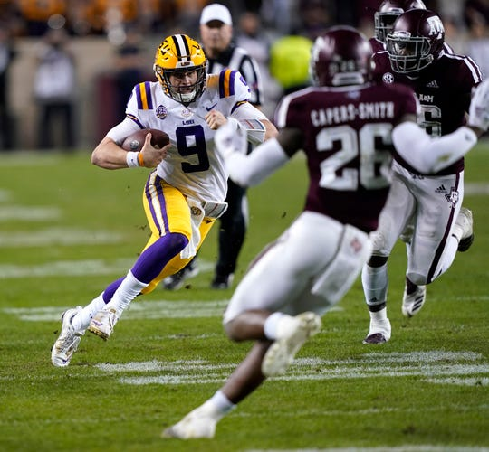 LSU quarterback Joe Burrow (9) rushes for a gain against Texas A&M during the first half of an NCAA college football game Saturday, Nov. 24, 2018, in College Station, Texas. (AP Photo/David J. Phillip)
