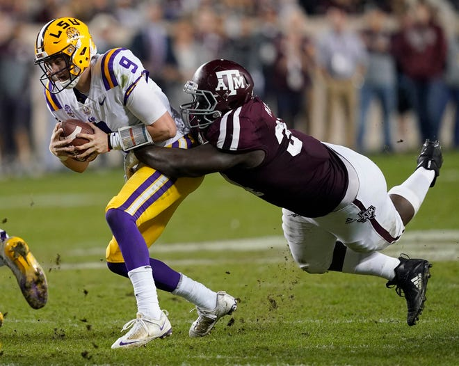 LSU quarterback Joe Burrow (9) is sacked by Texas A&M defensive lineman Daylon Mack (34) during the first half of an NCAA college football game Saturday, Nov. 24, 2018, in College Station, Texas. (AP Photo/David J. Phillip)