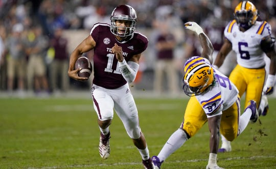 Texas A&M quarterback Kellen Mond (11) breaks away from LSU defensive end Glen Logan (97) during the first half of an NCAA college football game Saturday, Nov. 24, 2018, in College Station, Texas. (AP Photo/David J. Phillip)