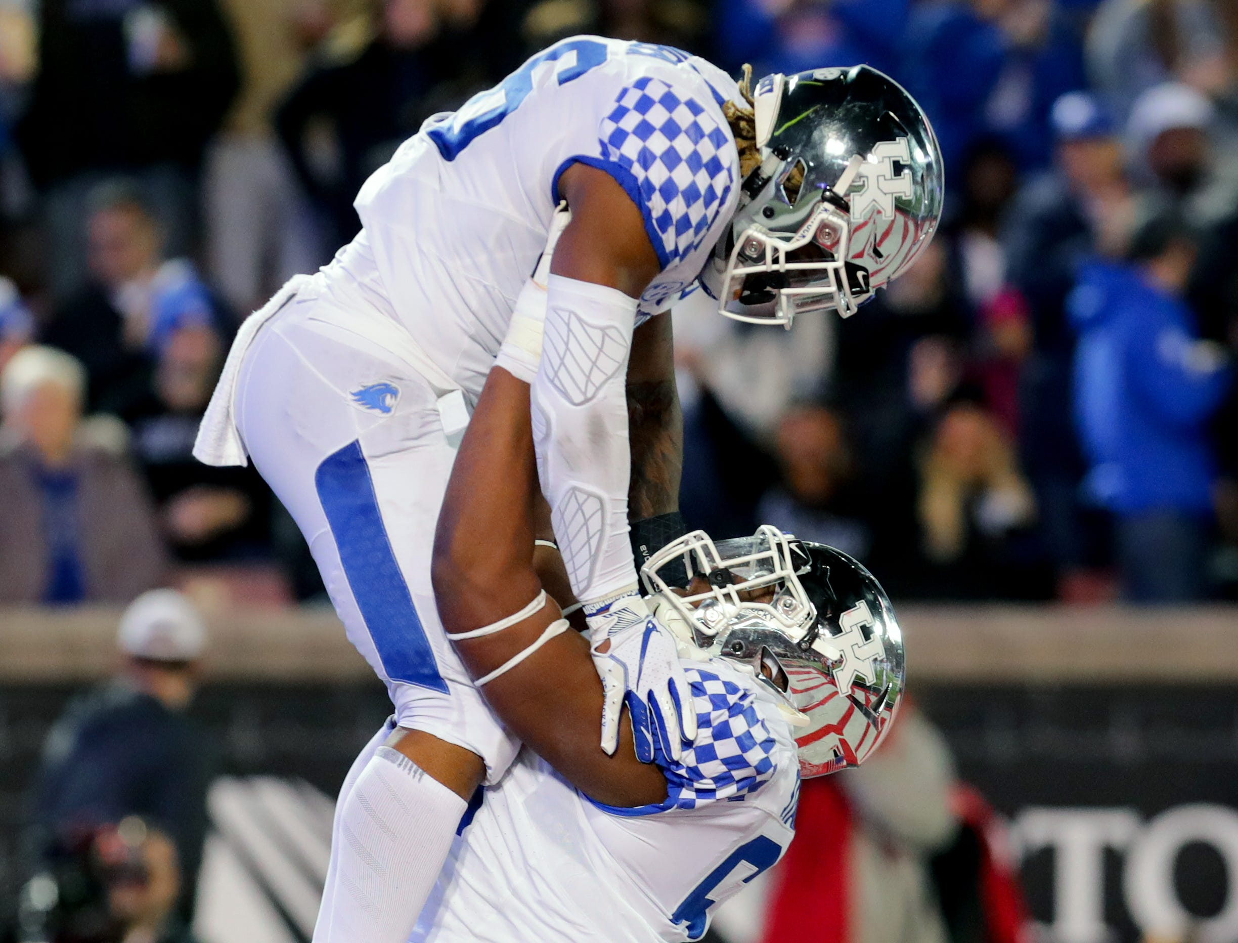 Kentucky's Sam Turner lifts Benny Snell Jr. up in the air after Snell scored a touchdown. Nov. 24, 2018