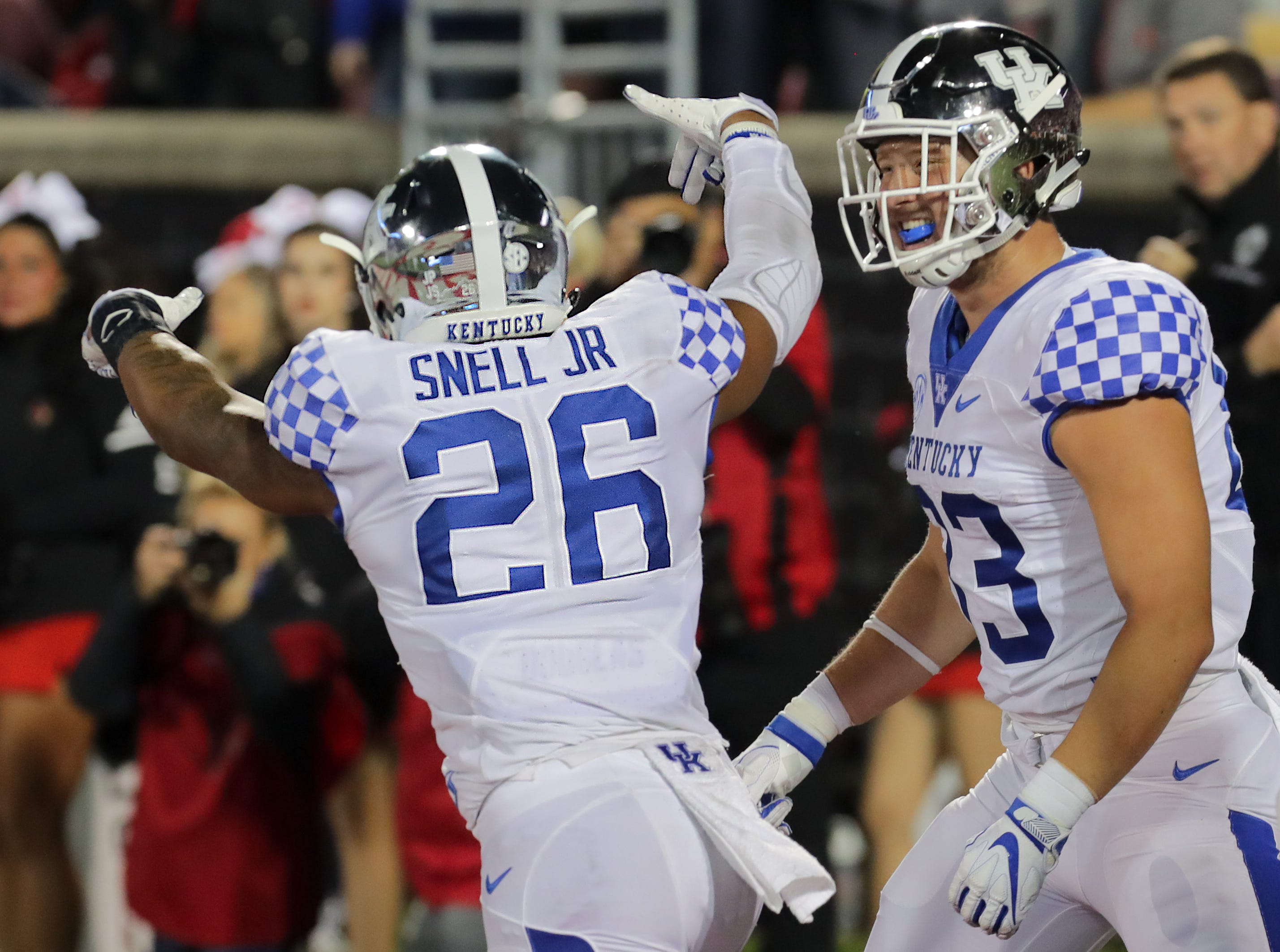 Kentucky's Benny Snell Jr. signals the upside down Ls after scoring another touchdown against Louisville. Nov. 24, 2018