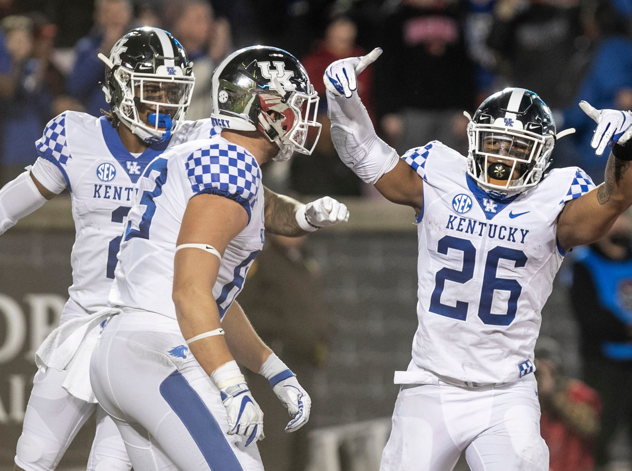 Kentucky's Benny Snell Jr. throws down the L's in disrespect after he scored his second touchdown against Louisville in the first half Saturday, Nov. 24, 2018.