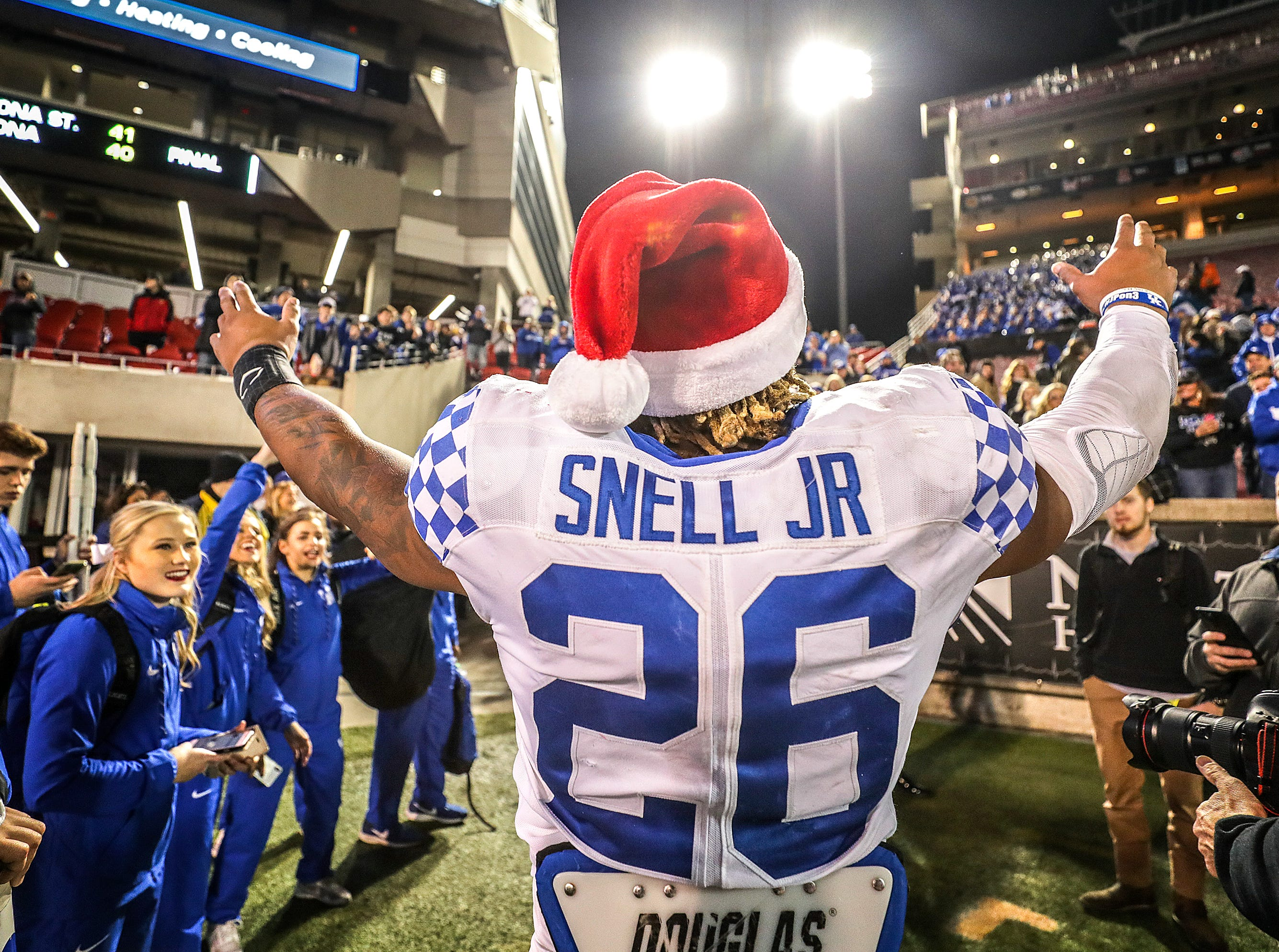Kentucky running back Benny Snell, Jr., celebrates with Kentucky fans after beating Louisville 56-10 at Cardinal Stadium. November 24, 2018