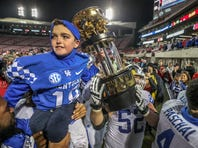 Luke Klausing is carried off the field on the shoulders of Kentucky players after UK defeated UofL winning the Governor's Cup on Saturday at Cardinal Stadium.November 24, 2018