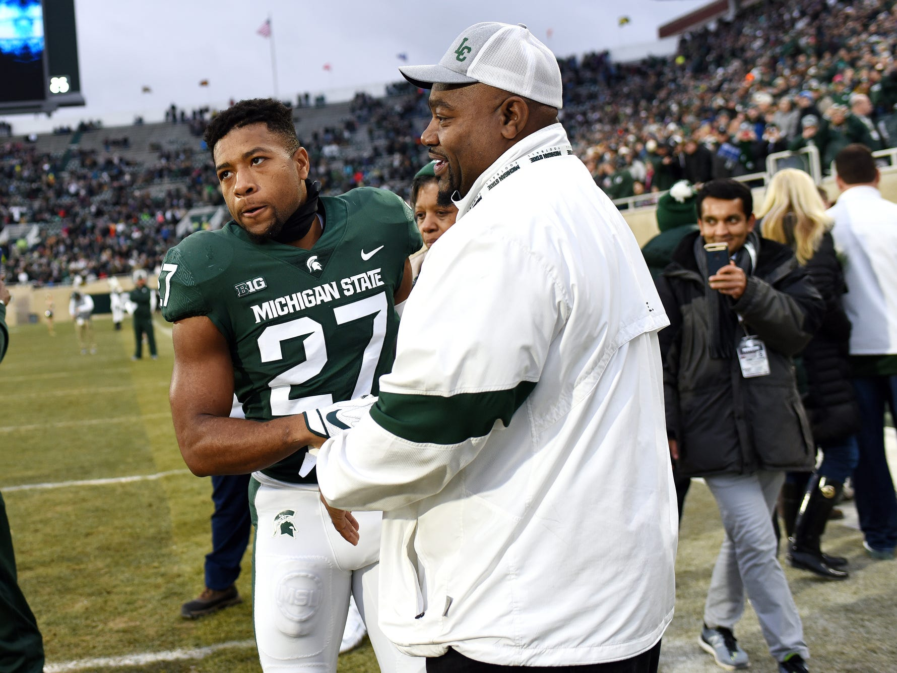 Michigan State senior Khari Willis, left, meets with family after being recognized before the game against Rutgers on Saturday, Nov. 24, 2018, at Spartan Stadium in East Lansing.