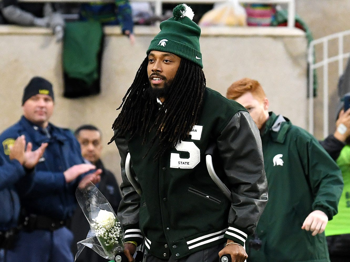 Michigan State senior Felton Davis III walks toward his family after being recognized before the game against Rutgers on Saturday, Nov. 24, 2018, at Spartan Stadium in East Lansing.