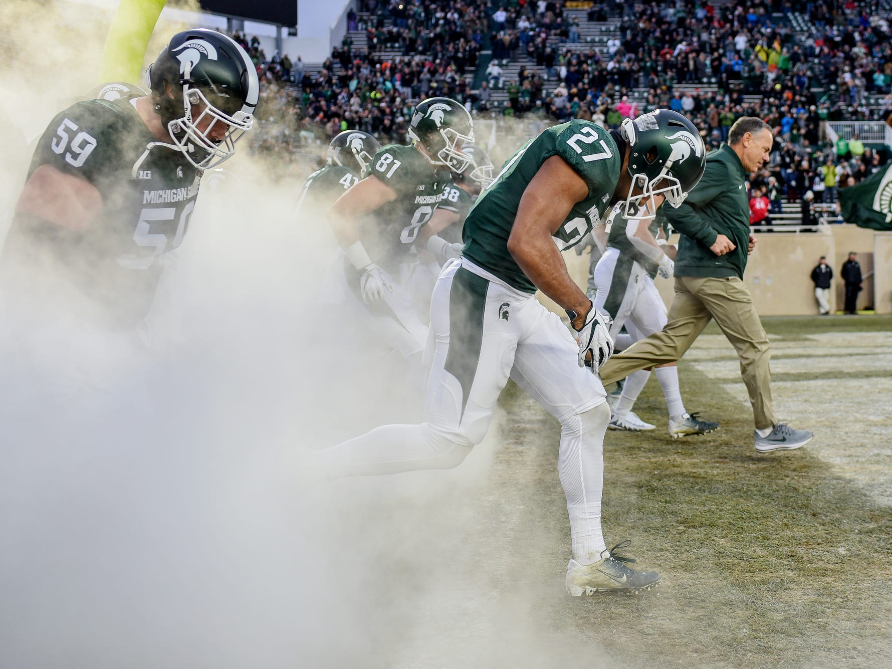 Michigan State's Khari Willis, center, takes the field with the rest of the team before the game against Rutgers on Saturday, Nov. 24, 2018, at Spartan Stadium in East Lansing.