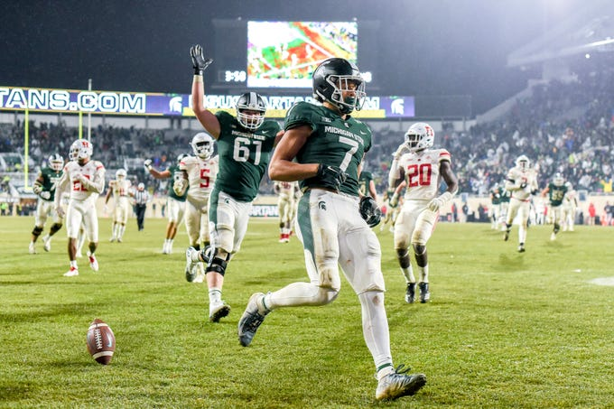 Michigan State's Cody White celebrates in the end zone after his touchdown run against Rutgers during the fourth quarter on Saturday, Nov. 24, 2018, at Spartan Stadium in East Lansing.