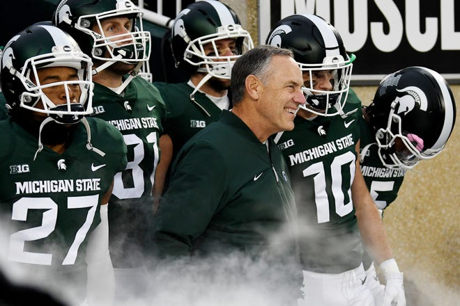 Michigan State head coach Mark Dantonio smiles as he and the Spartans prepare to take the field before the game against Rutgers on Saturday, Nov. 24, 2018, at Spartan Stadium in East Lansing.