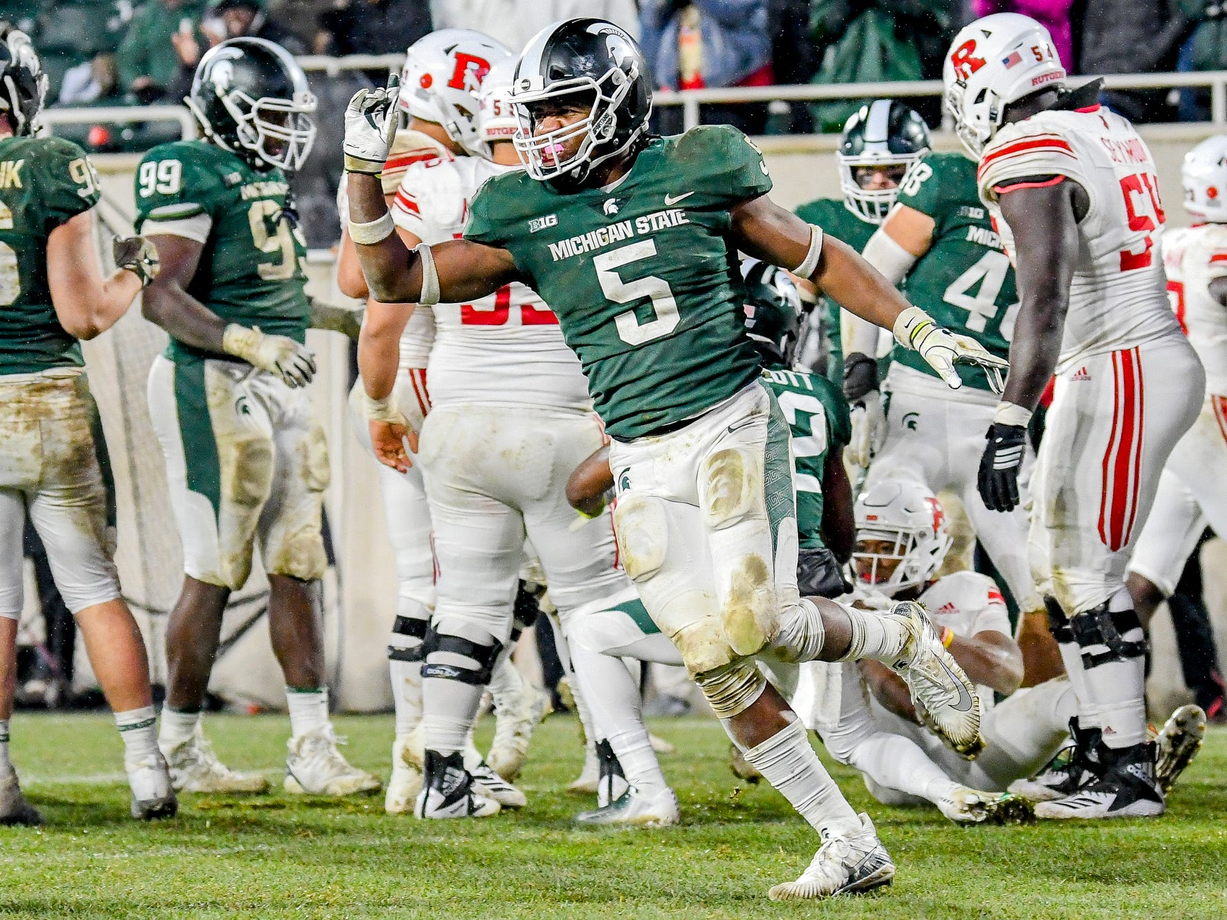 Michigan State's Andrew Dowell celebrates after a defensive stop during the fourth quarter on Saturday, Nov. 24, 2018, at Spartan Stadium in East Lansing.