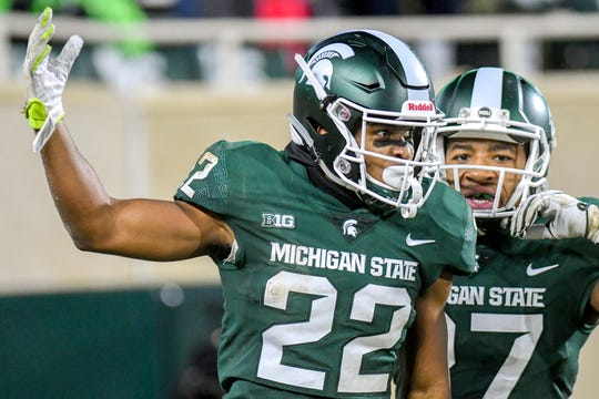 Michigan State's Josiah Scott, left, celebrates his interception with teammate Khari Willis during the fourth quarter on Saturday, Nov. 24, 2018, at Spartan Stadium in East Lansing.