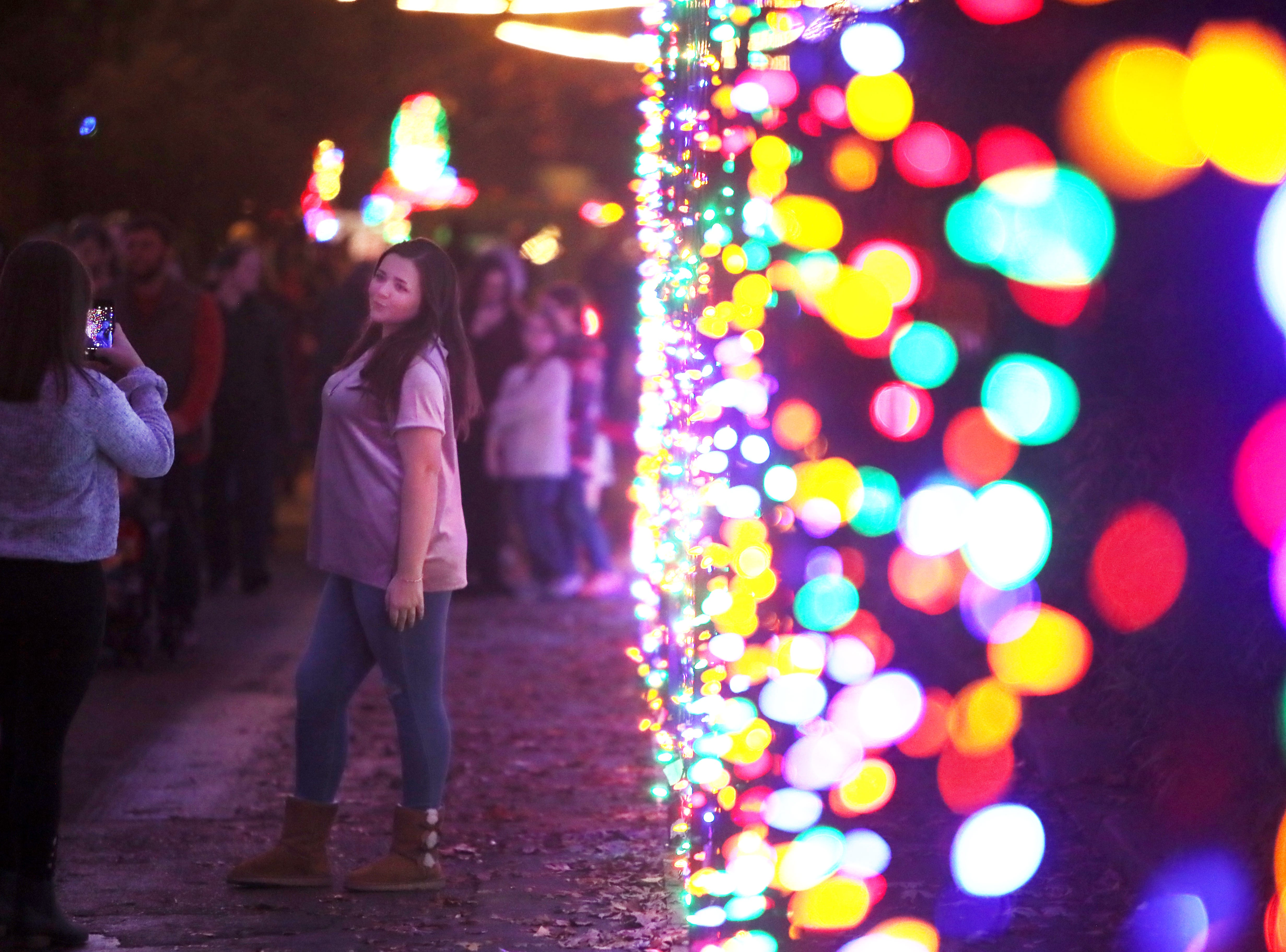 People walk through a lit tunnel at Zoo Lights, a holiday season themed event at the Memphis Zoo Saturday, Nov. 24, 2018.