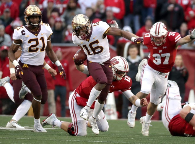 Wisconsin quarterback Alex Hornibrook attempts to tackle Minnesota's Coney Durr after the defensive back intercepted a pass during the first half on Saturday.