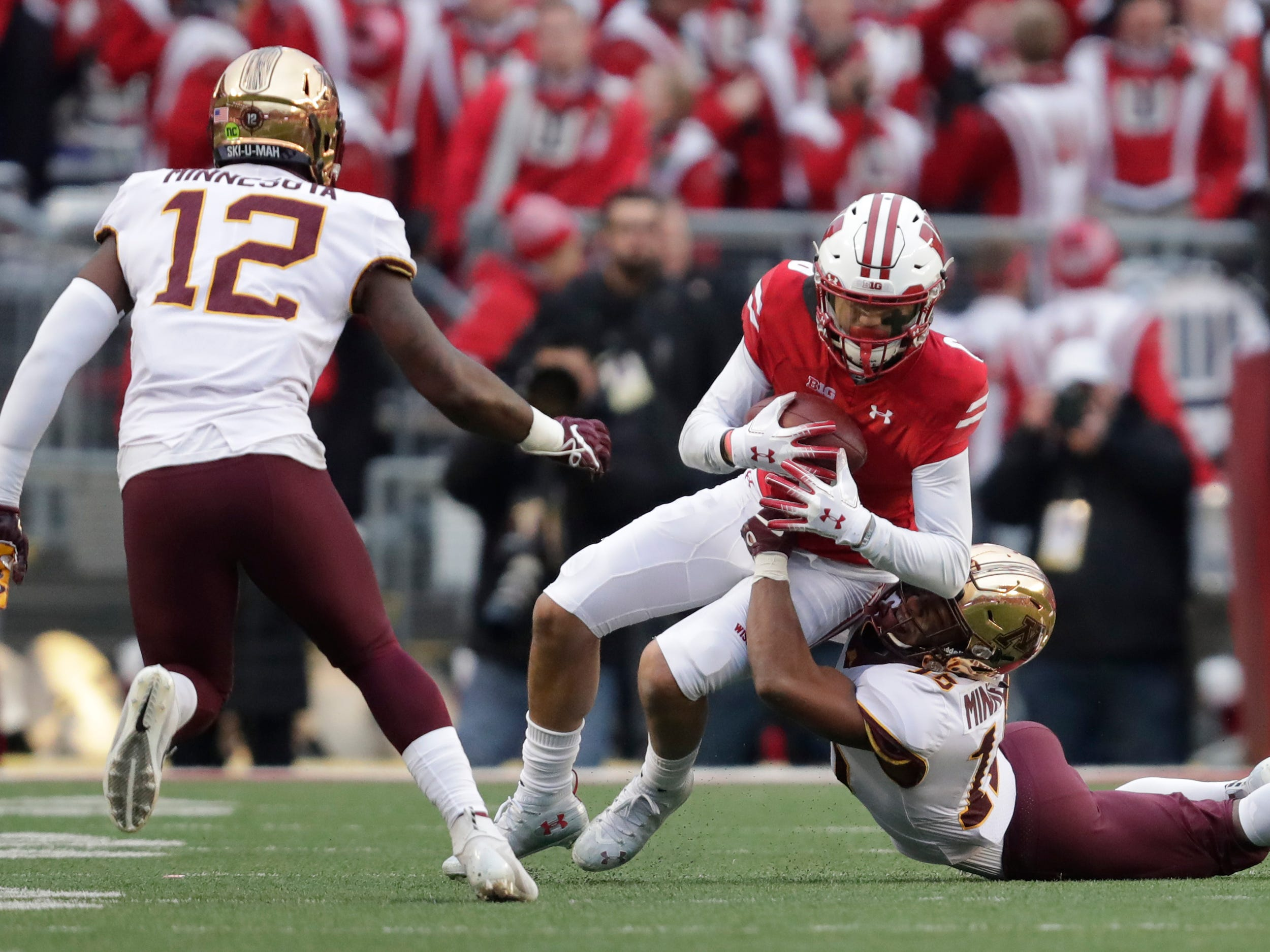 Wisconsin wide receiver Danny Davis  pulls down a reception as Minnesota defensive back Coney Durr tries to bring him down on Saturday.