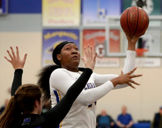 Milwaukee King's Sydnee Roby hits a quick jumper against Mukwonago's  McKenna Monoque during the showdown of the state's top two girls basketball teams during a basketball tournament at Brookfield Central, Saturday, November 24, 2018.  RICK WOOD/MILWAUKEE JOURNAL SENTINEL ORG XMIT: 20097247A