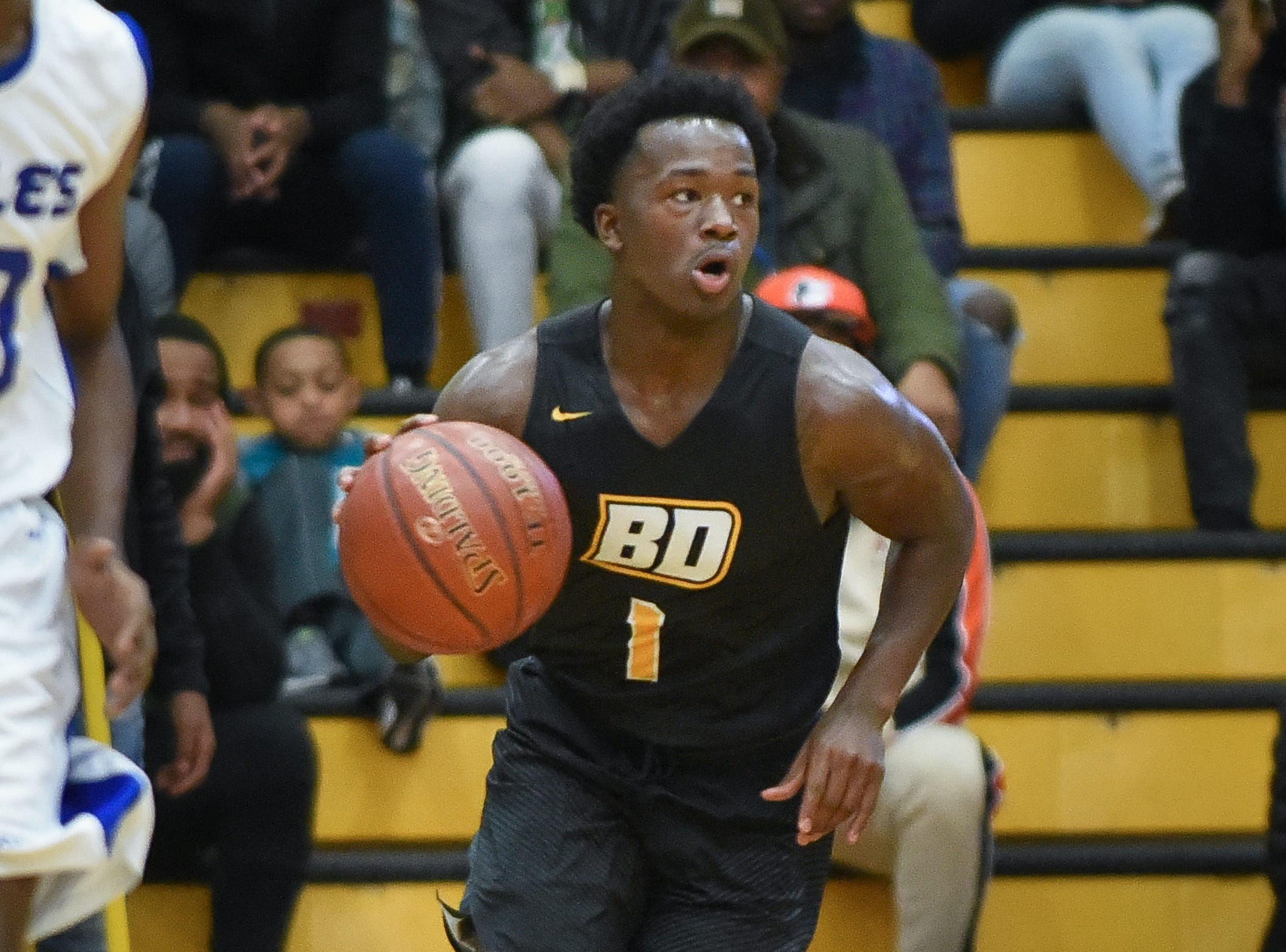 Brown Deer senior guard Jaylon Gentry brings the ball up court against Destiny in the Fresh Coast Classic basketball showcase Saturday, November 24, 2018, at UW-Milwaukee's Klotche Center.